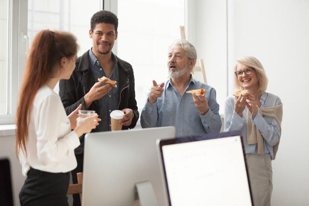 Colleagues talking around coffee | Claromentis