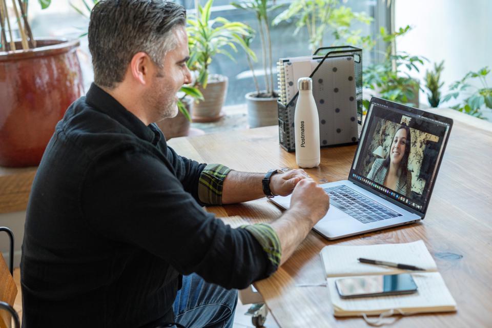 man-at-laptop-attending-remote-meeting