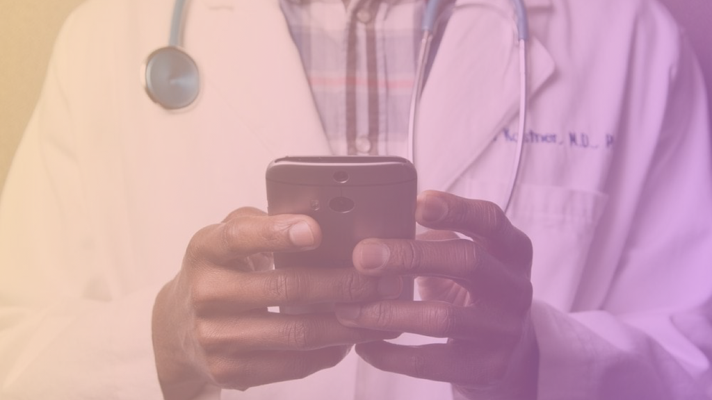 Image of a healthcare professional using his phone
